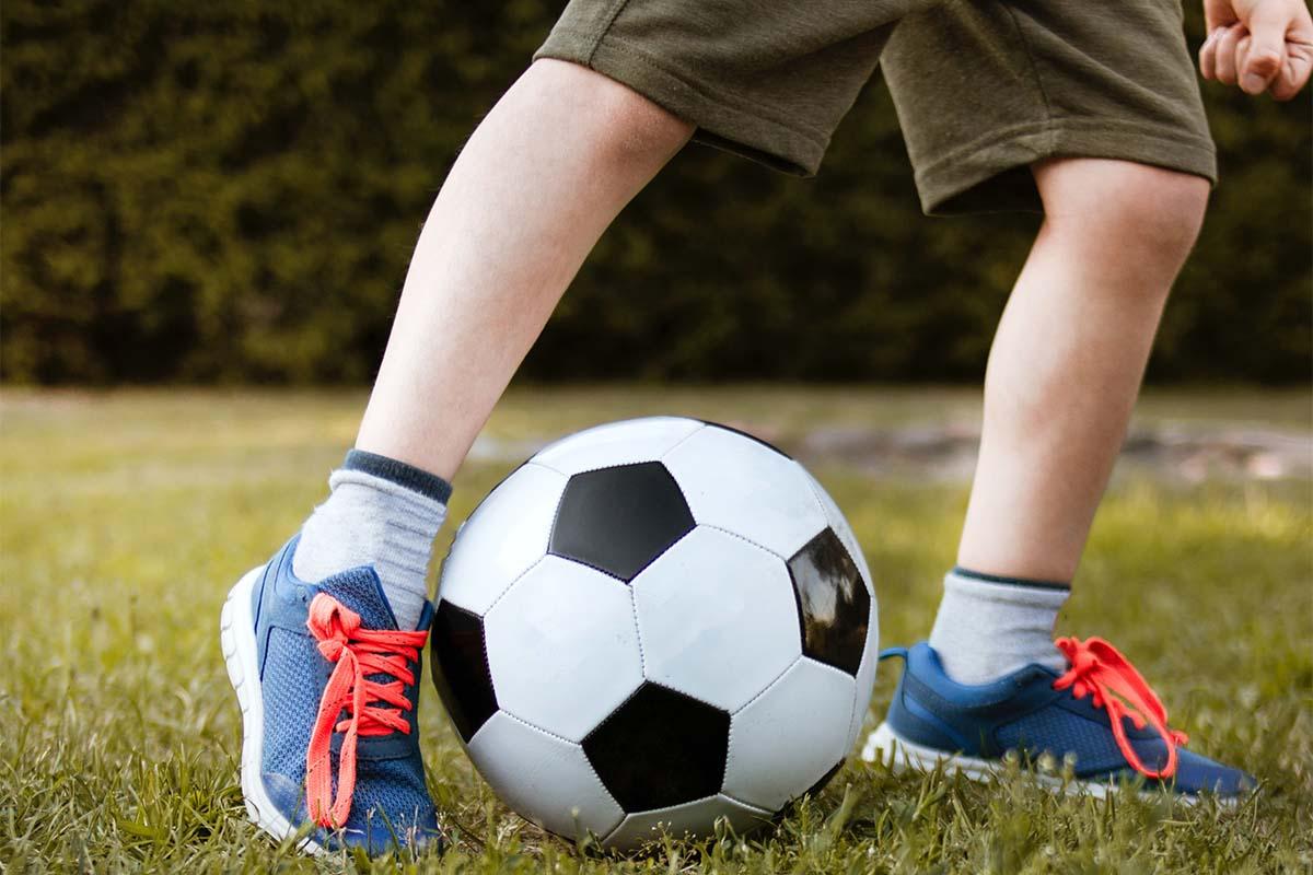 social distancing and sports (soccer kick)